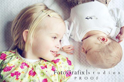 precious picture of newborn boy and big sister