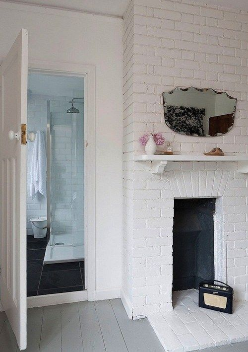 exposed white brick/ fire place