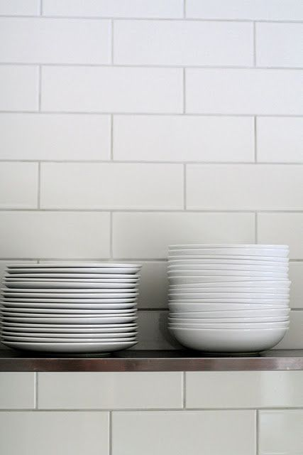 Subway tiles & white plates.