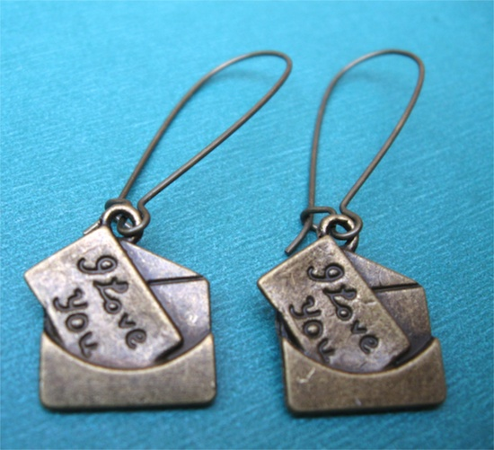 LOVE LETTERS earrings on French wires.   Still time!  $7.00.  www.etsy.com/...