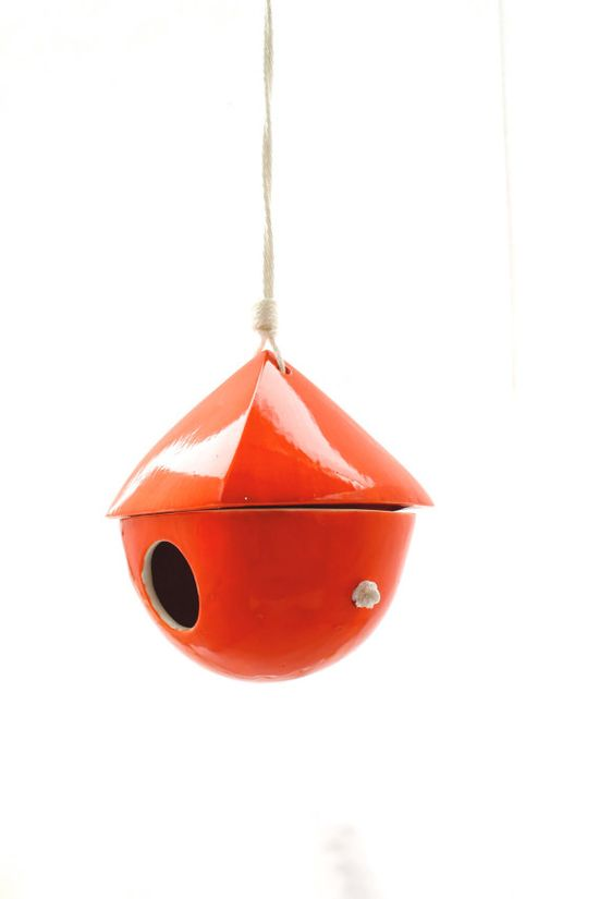 Get your garden started with a cheerful bird house.