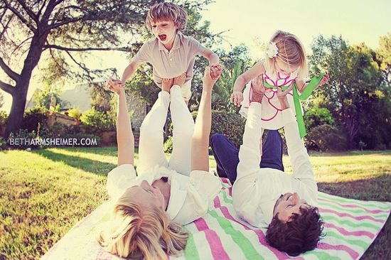 fun pose for family of four