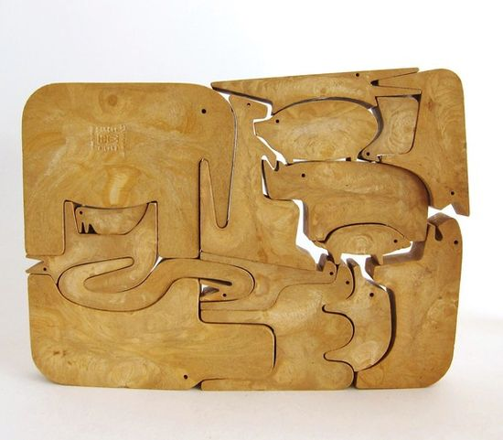 Wooden animal puzzle. Growing up my Mum used these on the table as a trivet for hot dishes :-)