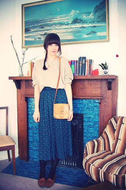Sweater + skirt + shoes + bag. Braid. Necklace.