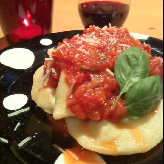 Handmade Ravioli stuffed with spinach, prosciutto, parmesan, and ricotta topped with a garlic basil marinara