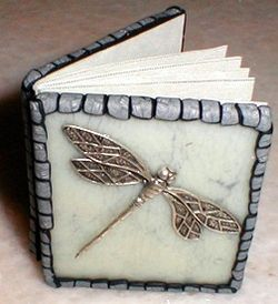 tiny clay covered book