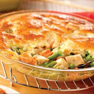 Easy Chicken Pot Pie Recipe - Instead of the milk, egg, and baking mix, just buy a pre-made pie crust and a tube of crescent rolls. The crescent rolls make the top of the pie really flaky and delicious