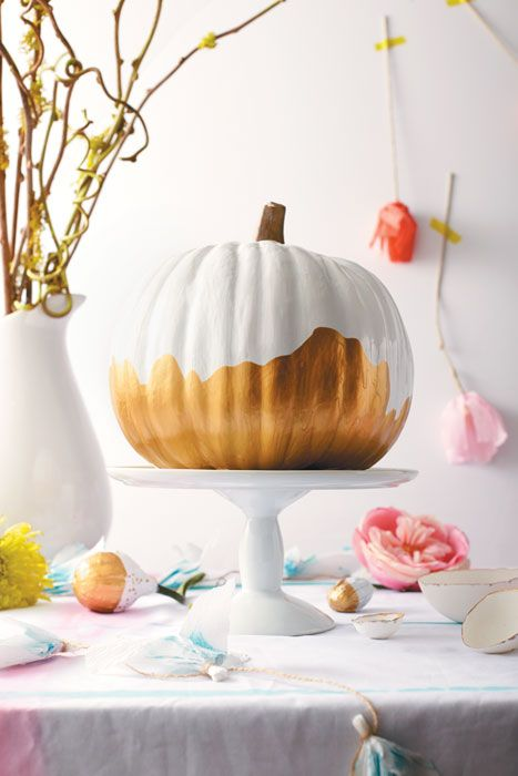 Spray-paint small gourds and pumpkins white. Once they're fully dry, dip the bottoms in gold paint. #Thanksgiving #pumpkin #diy