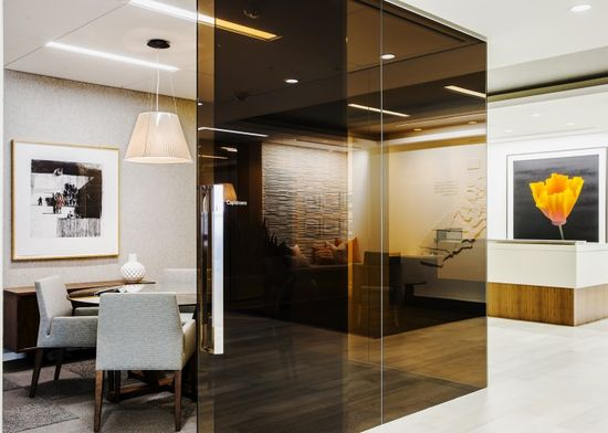 A sepia glass wall encloses a cozy conference room off the reception of the James Irvine Foundation in San Francisco. Interiors by ASD, San Francisco