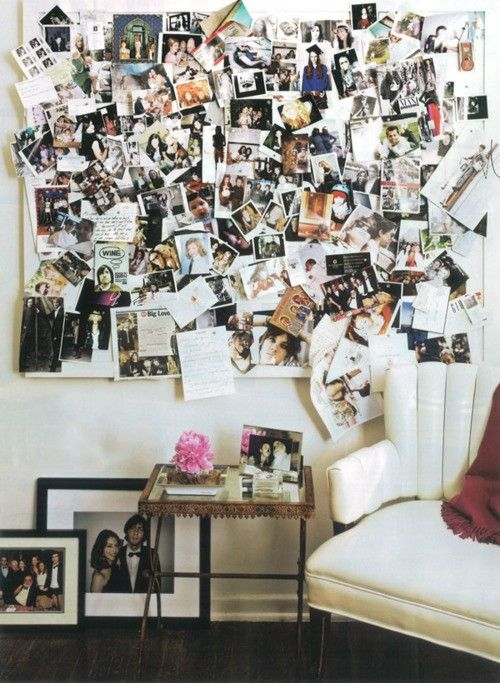 A photo wall in a home office can spark creativity.