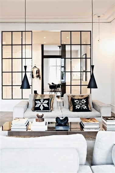 Monochrome - Love these Tom Dixion beat style light pendants with the black steel windows