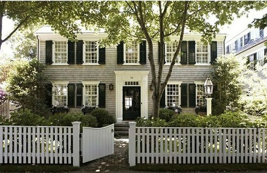 White picket fence surrounding a stately colonial, my favorite!!