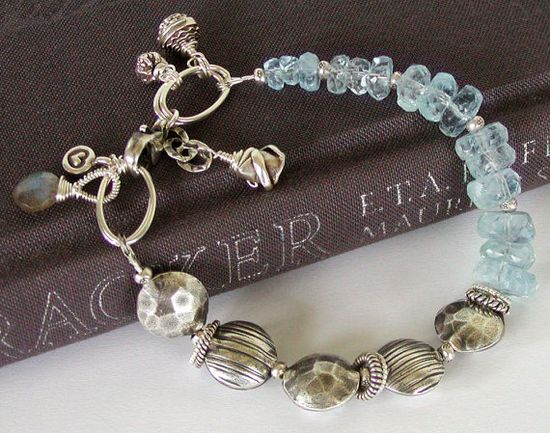 Shimmering Aquamarine bracelet composed of hand faceted icy blue Aquamarine and Artisan Hill Tribe fine silver beads. #jewelry #bracelet #Aquamarine