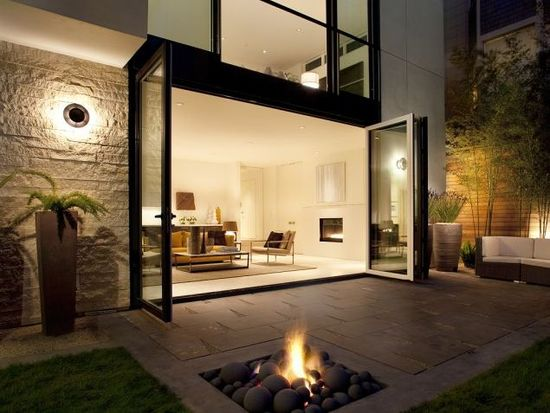 accordion door living room with fire-pit patio. completely loving this