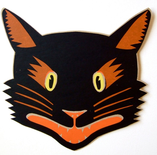 A fierce black cat with orange whiskers is a purrfect party decoration.