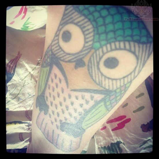 Blue Ink Owl Tattoo