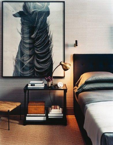 horse art, black bed, grasscloth, brass