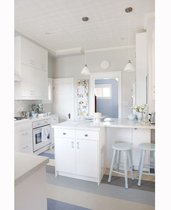 My next kitchen.  Love the baby blue stools and accents.