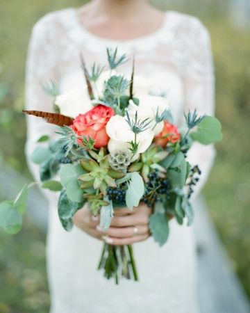 For southwest touches, feathers were added to this bouquet of roses, thistle, scabiosa, privet berries, and eucalyptus leaves, and the stems were bound with twine
