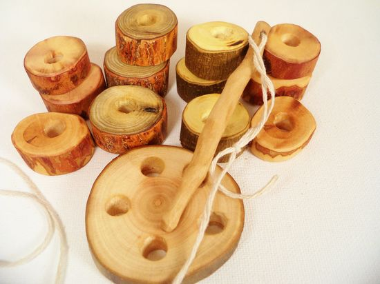 For fine motor skills. Great toy! :  Wood Sewing Toy Kit Waldorf Organic Eco Friendly Childrens Educational. $16.00, via Etsy.