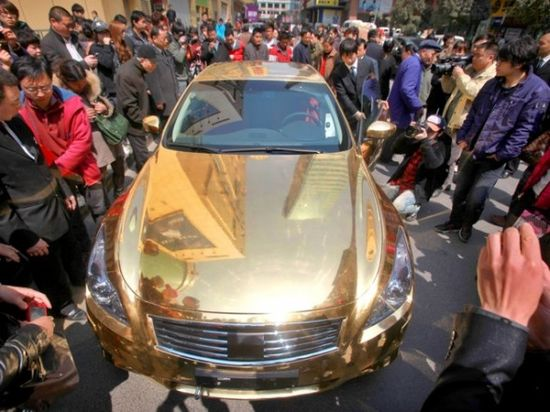 China's Internet Users Can't be Anonymous Under New Law     gold-plated Infiniti luxury sports car outside a jewelry store in Nanjing, in East China's Jiangsu Province, March 31, 2011. Corrupt officialsoften use their stolen money on extravagant luxury items like this. Now citizens will have more trouble exposing corruption due to new internet restrictions requiring using real names instead of pseudonyms.