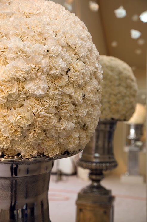 Silver Centerpieces...and white carnations smell WONDERFUL