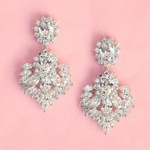Vintage Inspired Isabella Earrings    $89.95    These silvertone drop earrings feature a glamorous selection of round brilliant cut, oval and marquise cut gems, arranged into a charming setting perfect for an old Hollywood or vintage inspired look.