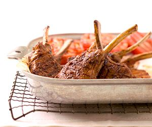 Succulent lamb chops get a savory kick from a dry rub in this quick-prep grilled dinner.