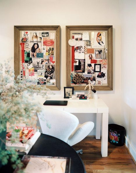A pair of inspiration boards above a white Parsons desk and an upholstered desk chair.