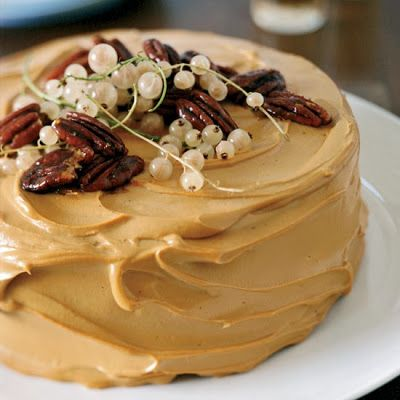 Pumpkin Cake with Caramel-Cream Cheese Frosting - In this fun variation on traditional pumpkin pie, pumpkin cake spiced with ginger, cinnamon, nutmeg and cloves gets frosted with a slightly tangy, super-caramelly frosting. It's delicious served cold or at room temperature.