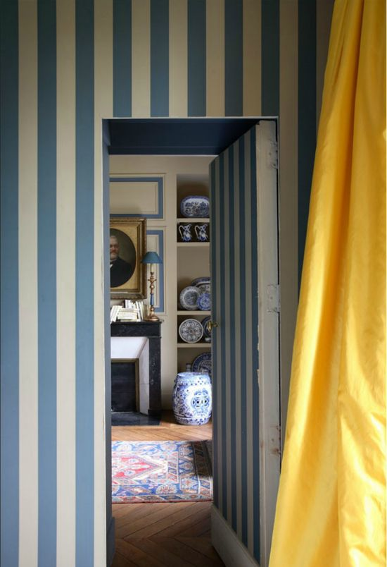 Stripes, yellow silk curtains, blue and white porcelain, old rug