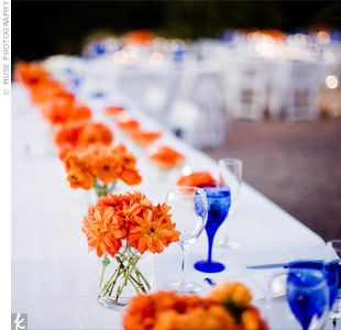 Would LOVE to have orange in my wedding.  Not too sure if that is going to be possible or not...  This is a great idea.  Orange Wedding Flower Arrangements