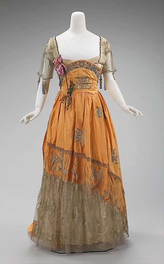 Evening dress House of Worth (French, 1858–1956) Designer: Attributed to Jean-Philippe Worth (French, 1856–1926) Designer: Attributed to Jean-Charles Worth (French, 1881–1962) Date: 1910–14 Culture: French Medium: silk, metal, rhinestones Dimensions: Length at CB: 88 in. (223.5 cm) Credit Line: Brooklyn Museum Costume Collection at The Metropolitan Museum of Art, Gift of the Brooklyn Museum, 2009; Gift of Mrs. C. Oliver Iselin, 1961 Accession Number: 2009.300.3235