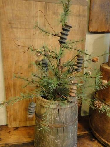 Primitive christmas tree... i would decorate it a bit differently but love the tree and barrel