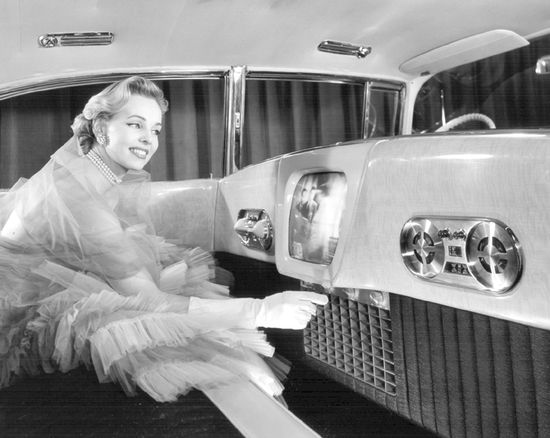 STRANGE OLDE LUXURY CAR ACCESSORIES - 1955 CADILLAC REAR SEAT TOYS - DECKED OUT PRODUCT MODEL ADJUST THE RAER AIR CONDITIONING DIAL JUST UNDER THE TELEVISION TUBE - AM/FM RADIO DIALS OFF TO THE RIGHT!
