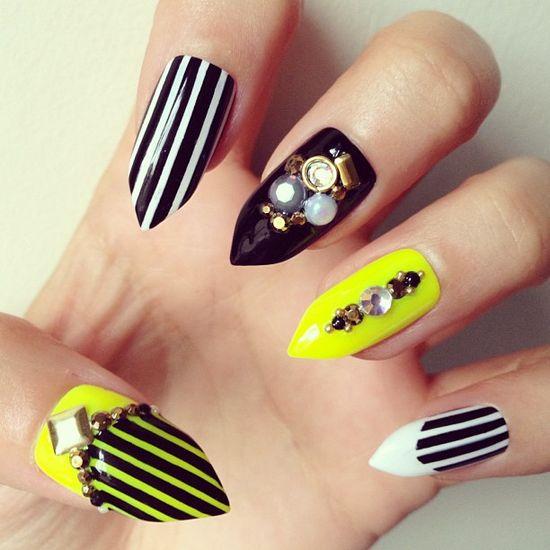 I cant get enough of that neon glow mixed with monochrome stripes ??? #nailart #nails #nailgasm #nailporn #naildesign #stilettonails #stripes #neon #black #monochrome #longnails #fashion #fakenails #falsenails #studs
