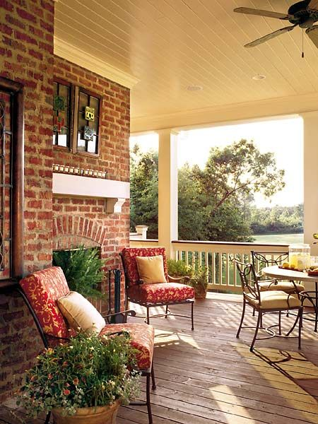 Porch with fireplace and furniture