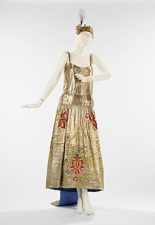 Dress, Evening  House of Lanvin  (French, founded 1889)    Designer:      Jeanne Lanvin (French, 1867–1946)  Date:      spring/summer 1923  Culture:      French  Medium:      silk, metal, feather  Dimensions:      Length at CB (a): 66 in. (167.6 cm) (b): 23 in. (58.4 cm)  Credit Line:      Brooklyn Museum Costume Collection at The Metropolitan Museum of Art, Gift of the Brooklyn Museum, 2009; Designated Purchase Fund, 1988  Accession Number:      2009.300.2228a, b