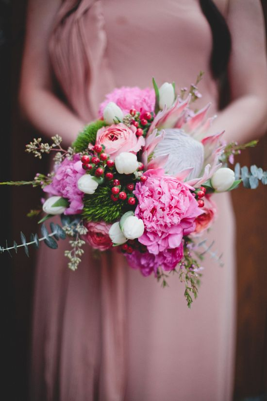 pink protea wedding bouquet // photo by TaylorLordPhotogr...