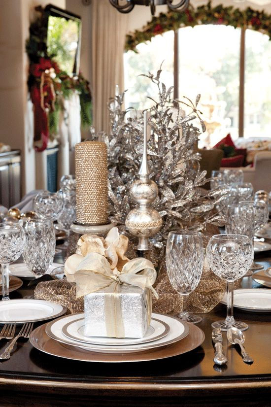 Gorgeous dining room table~ Decorated with beautiful crystal and silver metallic Christmas decor.