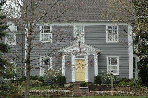 house colors...grey exterior, white trim, yellow door.