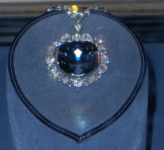 The Hope Diamond! Museum of Natural History, Washington D.C.    The weight of the Hope diamond for many years was reported to be 44.5 carats. In 1974 it was removed from its setting and found actually to weigh 45.52 carats. It is classified as a type IIb diamond, which are semiconductive and usually phosphoresce. The Hope diamond phosphoresces a strong red color, which will last for several seconds after exposure to short wave ultra-violet light. The diamond's blue coloration is attributed to t...