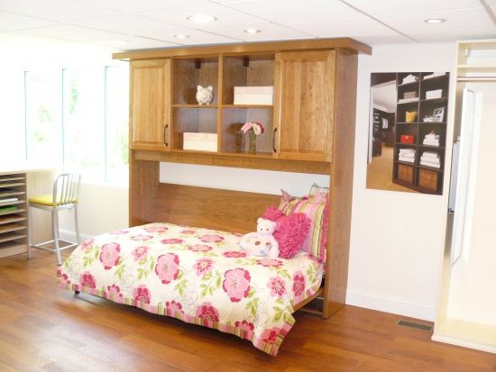 Hidden Wall Bed with Flower Motif Blanket and Wooden Floor