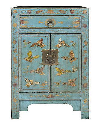 Asian style cabinet with gold detail.
