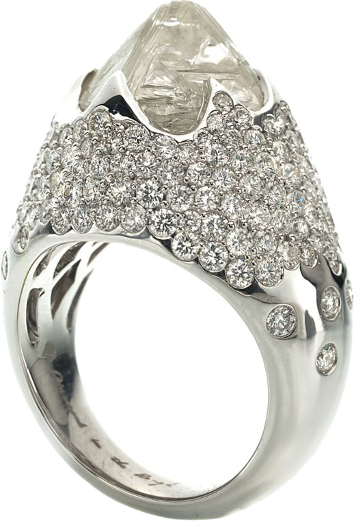 Iceberg ring featuring one octahedron rough diamond totaling 11.01cts accented with 3.27cts of pavé diamonds in 18k white gold.
