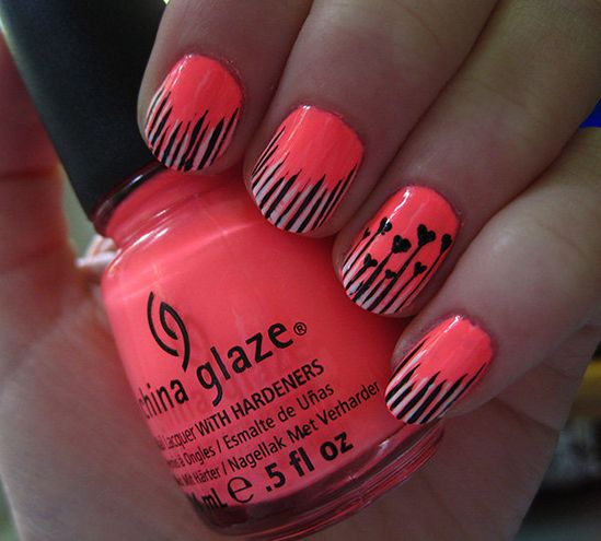 Emily's electric nails are so unique! We love the heart accent nail. #nailsoftheday #manicure