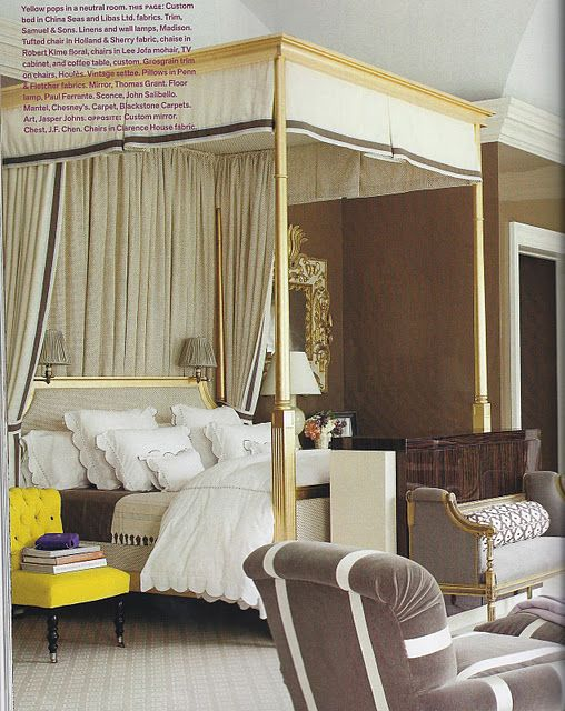 GOLD bed. yellow chair.