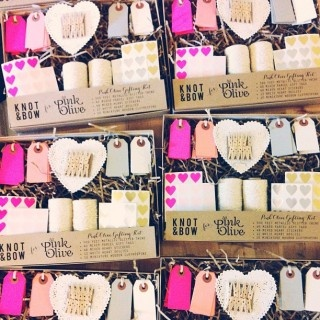 Really pretty gift tag and sticker kits by Etsy's Knot + Bow make more than 40 gifts