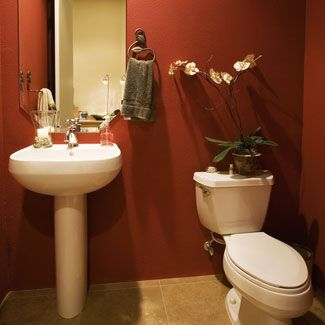 Small bathrooms don't have room for much decoration, so try a bold color on the walls.
