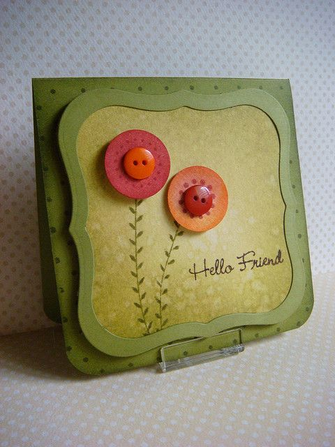 sweet handmade card in olive tones ... two orange & red round flowers with buttons ...